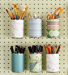 Pegboard - love the paper around the recycled cans
