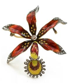 An Antique Enamel & Diamond Orchid Brooch, USA, circa 1890. A dark red, yellow and black enamel orchid brooch, with diamond accents. Mounted in 18ct yellow gold. #antique #ArtNouveau #brooch