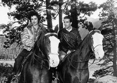 Elizabeth Taylor and Montgomery Clift riding horseback in a scene from the 1951 film A Place in the Sun.