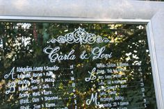 Lace painted detail on custom mirror seating chart with damask frame
