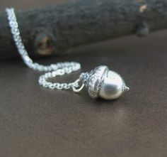 Cast acorn, sterling silver. I love this. It's super tiny too. My style.