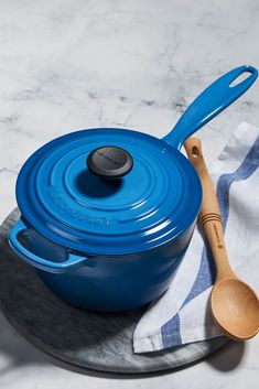 The smoothly curved interior and rounded base of the Signature saucepan make sauce making easier than ever. An extended helper handle and a contoured main handle also provide added control when transferring cookware on the stovetop or between the kitchen Enameled Cast Iron Cookware, Knobs And Handles, Le Creuset, Chefs, Sauces, Delicate, Foods, Medium, Building
