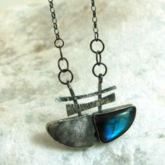 M Studio: Silver pendant with labradorite.