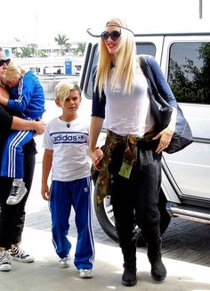 Gwen Stefani departs a flight out of LAX Airport with her boys Kingston and Zuma (July 26, 2013)