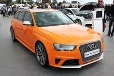 The new Audi RS 4 Avant made an appearance at the Goodwood Festival of Speed in an Audi Exclusive orange colour. Rs 4, Goodwood Festival Of Speed, Audi S4, Audi Sport, Audi Cars, Amazing Cars, Hot Cars, Audi Quattro, Custom Cars