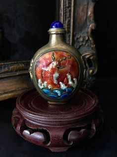 Antique snuff bottle Chinese metal hand painted gold enameled koi fish feeding brass spoon lapis cabochon top embossed lion jump rings each side 3 inch height    https://www.etsy.com/shop/CoCoBlueTreasures