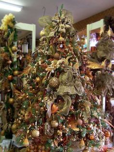 This pre-decorated artificial pre-lit Christmas tree features many glittering tree ornaments that are surrounded with little elves and beautiful angels! The sheer green ribbons add to the classy look of this tree.