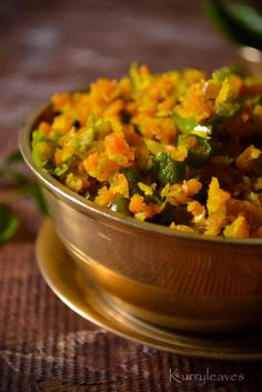 CARROT AND GREEN BEANS THORAN  Ingredients  Carrot- Chopped- 1 medium  Green beans- chopped-10 to 12 nos  Onion -chopped-1/2 nos  Green chili -chopped- 1 or 2 nos  Cumin powder-1/4 tsp  Turmeric powder-1/4 tsp  Curry leaves-few  Grated coconut- 2 to 21/2 tbsp  Oil  Salt to taste.
