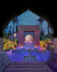 Beautiful lighting. Love the tile work and how the palms frame in the garden.