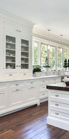 White kitchen design ideas. Love the cabinet for dishes, and that the cabinetry is ceiling height. #kitchenideasfarmhouse