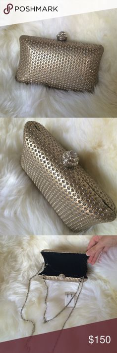 Gold party clutch New with tag gold party clutch! Fits all your essentials! Comes with a short and long chain. You can either wear it on your hand or over your shoulder. It's elegant! Bags Clutches & Wristlets