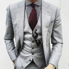 Grey on grey broken up with the a maroon tie. #greysuit by mens.suits