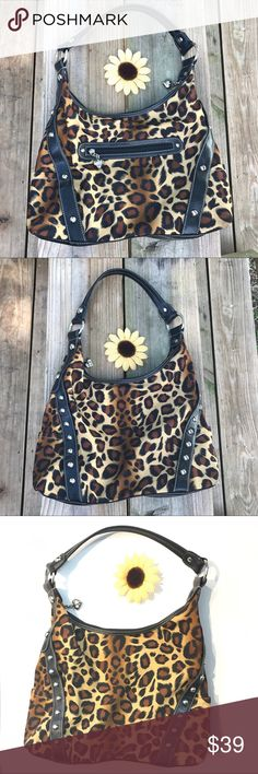 """Kathy Van Zeeland animal print handbag purse Kathy Van Zeeland handbag with beautiful silver hardware. Measures approximately 15"""" Width, about 14"""" height on the sides and almost 11"""" height in the middle, 3.5"""" depth and approximately 14"""" handle from the O ring to the other O ring. One back zip pocket, two outside small accented pockets, one inside zip pocket and three small compartment pockets inside. Has one small darker spot I just noticed on inspection - see photo - haven't tried to get it…"""
