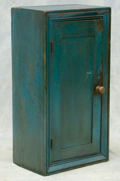 "Bunch Auctions Sale C150929 9/29/15 Lot 9205. Estimate $1,500-2,500. Realized $2,200. Blue painted one door wall cupboard, picture frame molding around case, 35 1/2"" h, 18 1/2"" w, scrubbed interior, 19th c, RCA, LLC (Raccoon Creek)."