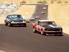 (16) George Follmer - Ford Mustang Boss 302 - Bud Moore Engineering - (9) Ronnie Bucknum - Chevrolet Camaro - Penske-Hilton Racing - 4th Annual Trans-American Sedan Championships Riverside - Trans-Am Riverside - 1969 Trans-Am, round 12
