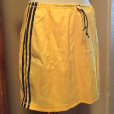 Bright yellow swim Aqua-fit hip wrap skirt Deep teal stripes on a bright yellow fabric. This is a fun skirt to throw on when you want to run into the store while wearing your bikini. Unique drawstring  elastic waist. Adidas Skirts Mini