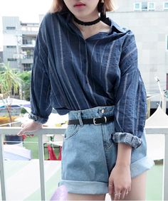 Oversized shirt with a pair of high waist jeans cinched at the waist with a thin belt <3 K-Style perfection! With a pair of converse or slip on shoes would be perfect! Or even some chunky boots for a more statemented look :3 (credits to owners)