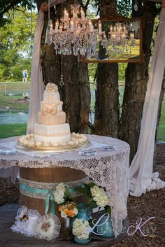 spool cake table with lace linen