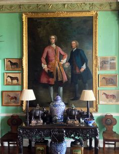 Classic old Irish Interior with pistache walls and Portraits, also blue and white porcelain, horse paints in compose with the large portrait/ Interior Glin Castle Limerick County/ Irland.