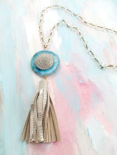 """""""One Foot on Shore"""" - 1940's steel cut button layered over turquoise quartz stone accented with a metallic silver leather tassel"""