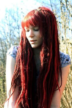 so beautiful.. love bangs with dreads.. and all the vibrant reds.. all around amazing!