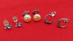 Add vintage style to your ensemble with vintage sterling silver earrings.