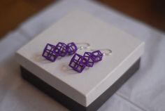 These totally appeal to the geek in me.  :)     Rhombic Dodecahedron earrings by bytestobits on Etsy, $32.00