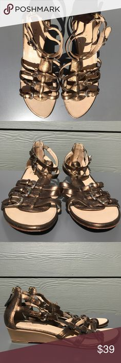 Talbots EUC bronze gold metallic gladiator sandal Talbots bronze gold supple metallic leather gladiator sandal with small wedge and back zipper. Selling for my mom, such soft leather and haven't been worn much. Small amount of wear at toe in pics included, and tiny leather wrinkle that came like that in pic included. EUC Talbots Shoes Sandals