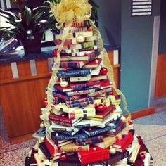 17lettersfromark:    This is what we do with our college education at work. #library #christmas