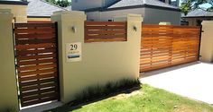 This lacquered wooden sliding gate is truly elegant in design. The gate is made of wood, yet has been properly fitted to enable the gate to slide open or closed with the ease of a remote.