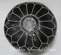 Black pouf with white stiching