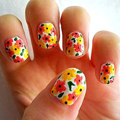 White nails with simple orange and yellow dot, drop flowers, free hand nail art
