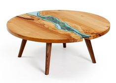 A body of replicated water flows through the design of the table.  Designed by furniture maker Greg Klassen.