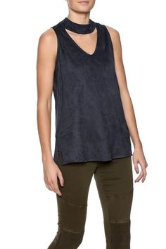 Navy Suede Sleeveless Keyhole Top ($64) Embrace the keyhole cutout craze with this navy, faux suede sleeveless top. Its a perfect match for your favorite skinny jeans, structured leggings and print bell bottoms.