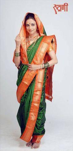 a simple n beautiful green nauvari saree on beautiful women...