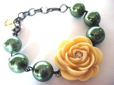 Irish Rose Bracelet - Faux chunky green pearls with a pale yellow Swarovski rose at its center $17