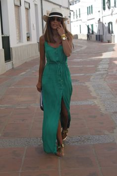 A colorful maxi is a vacation style must! Add strappy sandals and a straw hat and you've got the perfect summery look.