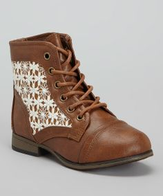 """Trendy, sturdy and made for trekking—these boots mean business. Style business, that is! Boasting lovely lace panels and a comfy low heel, this sweet silhouette will have little feet ready for action.0.75"""" heel5.25"""" shaft9.5"""" circumferenceSample size 13Lace-upMan-madeImported"""