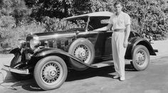 Johnny Weissmuller  Romanian-born American actor Johnny Weissmuller (1904-1984), who won five Olympic Gold medals for swimming before becoming famous for his role as Tarzan in 1932, poses with his '32 Chevy.