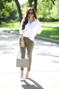 The Sweetest Thing: Styling An Oversized White Button-down - Oversized white button-down + army green skinny jeans + nude coach handbag + statement earrings / Casual and chic spring or winter outfit
