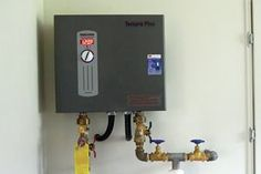 Electric Water Heating for a Low-Load Home - For less than $1,000, I was able to purchase the materials (heater, service valve kit, scale inhibition system, electric cable, and fittings) and one hour of my electrician's time to install the Tempra 24 Plus. That does not include my time to hang the unit and plumb the valves nor the time to run the PEX—all of which I estimate to be an additional four to six hours. A comparable propane installed tankless system would run $3,000 or more.