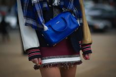 Chiara Ferragni dressed up a varsity jacket with a bright blue Saint Laurent bag - Street Style Accessories #NYFW