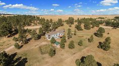 Equestrian Estate for Sale in  Elbert County in Colorado. Very private 35-acre estate with views, pastures and trees, trees, trees! Huge 11-stall 48'x60' barn with tack room and storage! Mats and power in each stall. Barn is well lit inside and out! Hay storage behind barn. Separate the animals with 6 cross-fenced paddocks with horse safe fence. Includes 20x24 loafing shed with water, power and lights. Great pasture and outdoor arena 95x220.