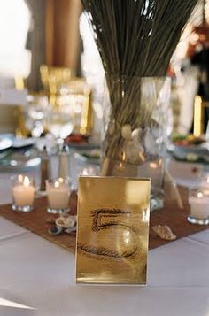 beach wedding table numbers - numbers drawn in the sand