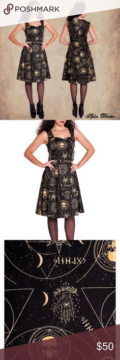 Goth Wicca pin up dress new small occult Brand new dress from brand spin doctors that I have never worn and is new with tags. I bought it online from a boutique. Very cute Halloween occult print with faux leather side straps and a zipper. Hot Topic Dresses