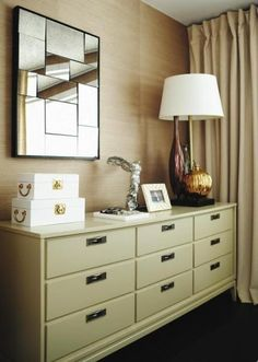 Principal bedroom vintage dresser and table lamp, collectibles, grasscloth wallpaper - Arren Williams Design Lab | House & Home | Photography: Angus Fergusson
