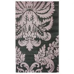 Hand-carved wool rug with a damask motif.  Product: RugConstruction Material: 100% WoolColor: Purple and greyFeatures:  Made in IndiaHand-carved Note: Please be aware that actual colors may vary from those shown on your screen. Accent rugs may also not show the entire pattern that the corresponding area rugs have.Cleaning and Care: Spot treat with a mild detergent and water.  Professional cleaning is recommended if necessary.