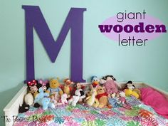 Giant wooden letters! Good idea for family room decor!