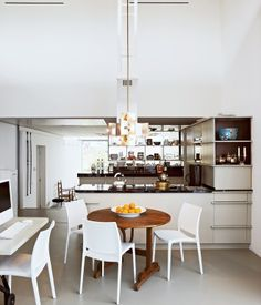 Kitchen frames a natural division between  public and private spaces.