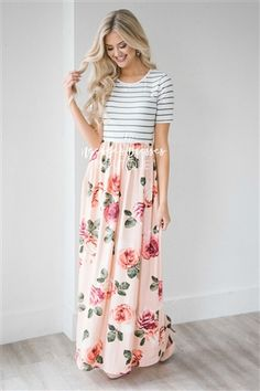 When beautiful meets comfortable! The Sasha is oh so pretty! Featuring a olive and ivory striped bodice and followed by a gathered waist and pastel peach maxi skirt with a floral print.
